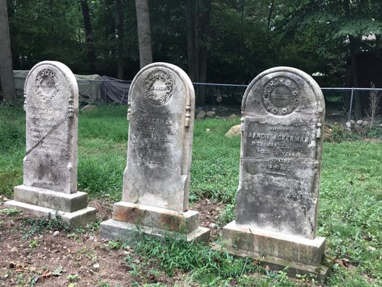 Fallen Ackerman head stones have been returned to an upright position, glued back together with a special weather-resistant adhesive.