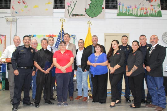 Pictured, from left, are Luna County Manager David McSherry, Deming Police Chief Alex Valdespino, Luna County Commissioner John Sweetser, Fr. Manuel Ibarra, DPD Captain Louis Tavizon, Barbara Ammirati, U.S. Sen. Martin Heinrich, irector of Shelter Operations Ray Trejo, City Administrator Aaron Sera, Dept of Workforce Solutions Nicki Casillas, Colores United Ariana Saludares, Deming Fire Chief Raul Mercado, Colores United Monica Topham, DFD Battalion Chief Edgar Davalos and Deming Mayor Benny Jasso.