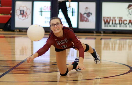 Sophomore Lady 'Cat Lily McMillan stretches for a dig.