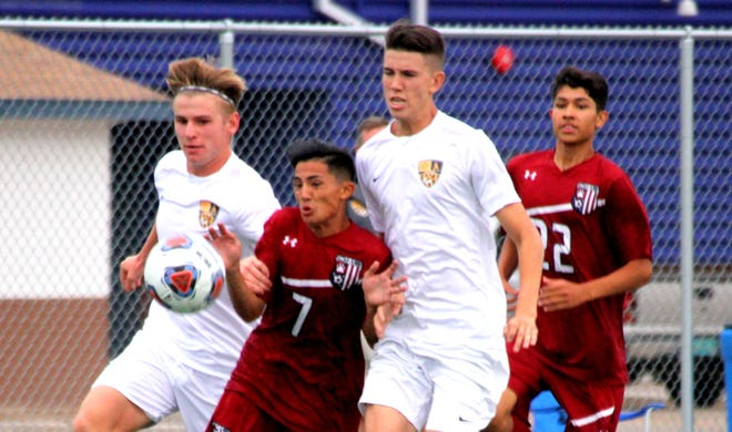 """Sophomore Wildcat forward Cipriano """"Cippy"""" Gonzalez (7) shouldered a double-team throughout Tuesday's home match against Alamogordo but provided the winning goal in a 1-0 victory."""