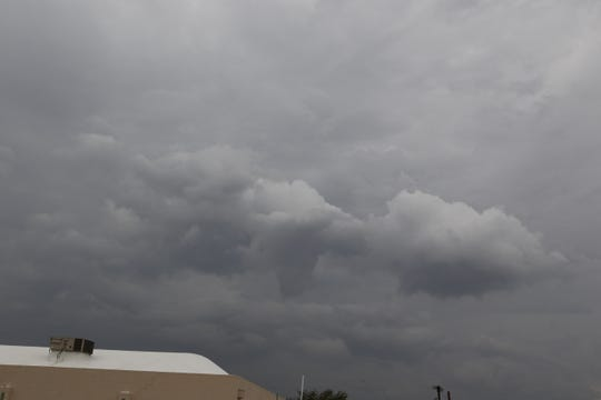 Storm clouds form north of Carlsbad Oct. 3. Drier weather was forecast for the weekend, according to The National Weather Service.