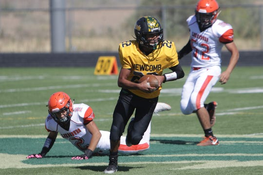 Newcomb quarterback Deondre Begay, seen here in a non-district football game against Lordsburg on Saturday, Sept. 21 in Newcomb, has 1,215 total yards of offense through six games in 2019.