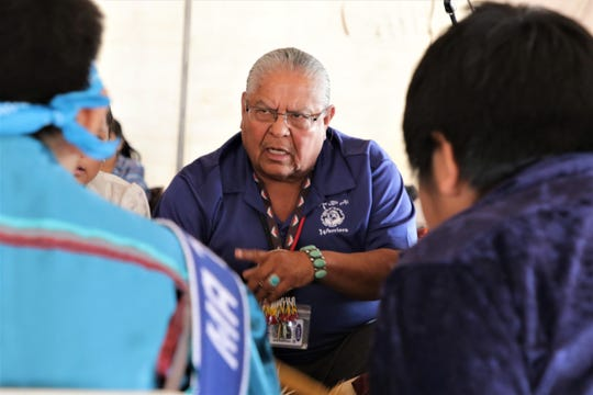 Tsé Bit'a'I Middle School heritage language teacher Elvin Keeswood leads a student drum circle, Thursday, Oct. 3, 2019, during the 108th Northern Navajo Nation Fair in Shiprock.