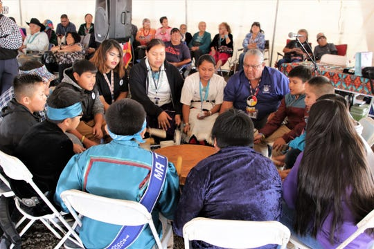 Tsé Bit'a'í Middle School heritage language teacher Elvin Keeswood leads a student drum circle, Thursday, Oct. 3, 2019, during the 108th Northern Navajo Nation Fair in Shiprock.