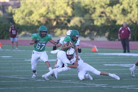 Farmington quarterback Caleb Carrillo, seen here running the ball against Belen on Friday, Aug. 30 at Hutchison Stadium in Farmington, has 1,568 passing yards after the first six weeks of the 2019 season.