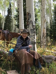 Shay Pendray takes a break from driving cattle in Wyoming last month.