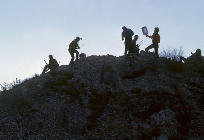 Attendees of Mojave Auszug in Box Canyon in Mecca. Calif. were greeted by Djemaa el Fna playing on top of the canyon. March 4, 1984.