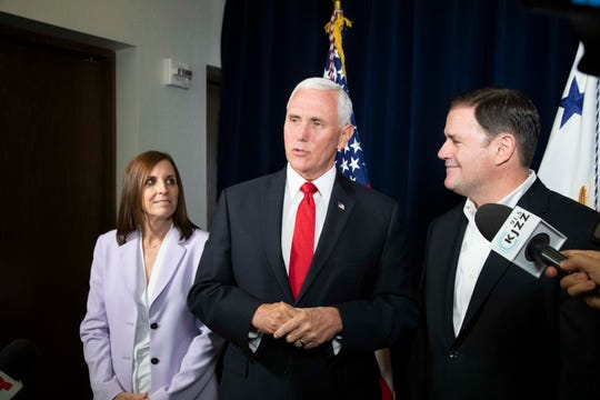 Vice President Mike Pence appears in Arizona on Oct. 3, 2019, with Sen Martha McSally and Gov. Doug Ducey.