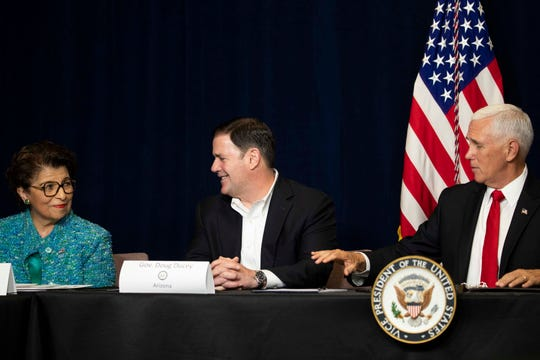 Gov. Doug Ducey, center, participates in a rountable discussion on Latino issues with U.S. Treasurer Jovita Carranza and Vice President Mike Pence on Oct. 3, 2019.