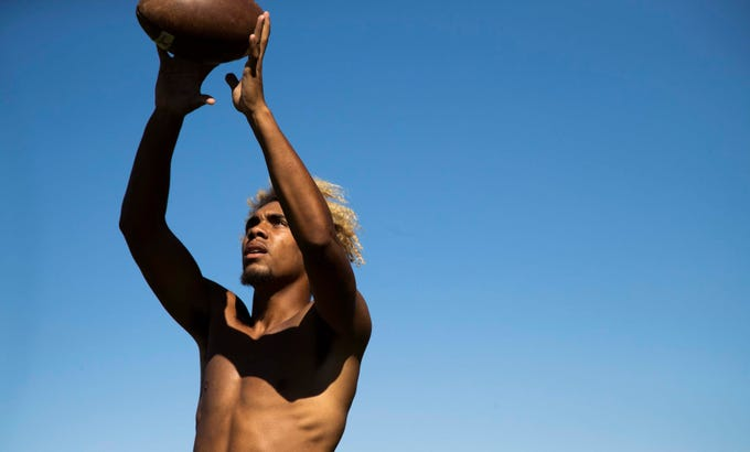 Receiver Zavier James of Perry High School football team gets ready during a daily practice.