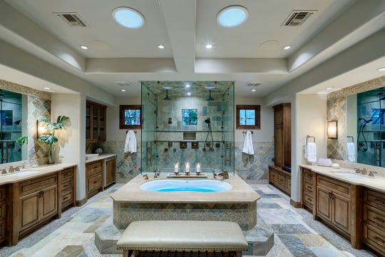 The $2.6M Mesa mansion, purchased by Jeanette and David Bloss, Sr., has a luxurious master suite with a spa-like bathroom.