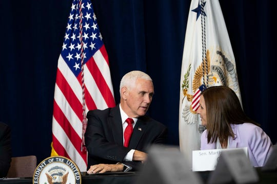 Vice President Mike Pence talks with Sen. Martha McSally on Oct. 3, 2019, in Scottsdale.