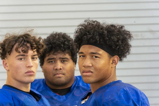 Chandler High School football players from L to R. Gunner Maldonado, Lingi Havea, and Bryant Jackson during their practice.