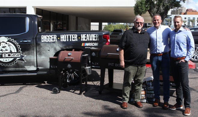Dan Theissen and his sons Jeff and Jordan in front of their Danson grills.