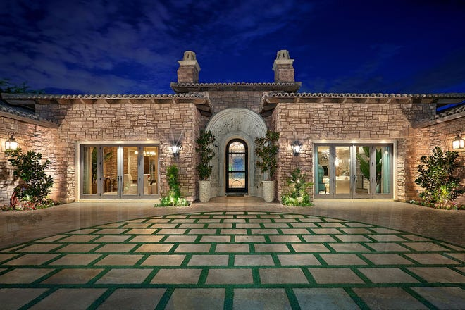 This $2.6M estate, sold by Sandra Crittenden, features a courtyard and Italian inspired landscaping.
