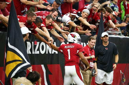 Arizona Cardinals quarterback Kyler Murray (1) celebrates his first rushing touchdown with the fans against the Seattle Seahawks in the second half during a game on Sep. 29, 2019 in Glendale, Ariz.