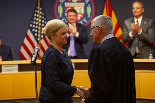 lister Adel is congratulated after being sworn in as the Maricopa County attorney on Oct. 3, 2019.