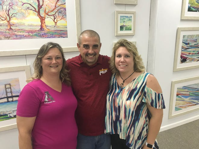 Entrepreneurs Amy Amiels, from left, Chris Campbell and Sandee Kuhfeldt opened up Dock 421, a new co-working space in Algonac, on Tuesday, Oct. 1, 2019. They said they hope to help other business owners.