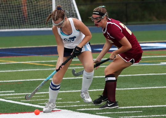 From left, John Jay's Abby Mohl (15) and Arlington's Margaret Bryne (21) battle for ball control during field hockey action at John Jay High School in East Fishkill Oct. 2, 2019.  John Jay won the game 2-1.