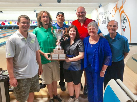 Greg Elicker and Jen (Elicker) Sparks hold the Mike Elicker Memorial Team Challenge Cup as their Colony Park North No. 3 teammates Alex Ludwig, left, Chad Ruby and Travis Sparks look on.  Judy Elicker, second from right, presented the trophy and Don Smith, right, was the tournament director.