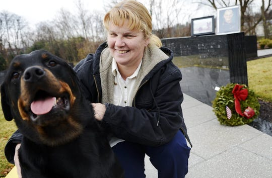 Sgt. Christopher Wrinkle's mother, Joan Snyder, is pictured in 2012 along with her son's civilian dog, Alex.