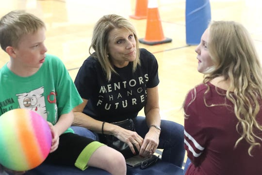 Volunteer mentor Dina Williams, center, talks with Turtle Bay School students Nate Latta and Ava Muckel during their mentoring time at lunch Wednesday, Oct. 2, 2019.