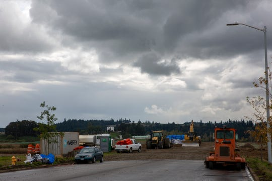 A combined city and state floodplain grading project winds down along Kuebler Blvd. in Salem, Oregon, on Oct. 3.