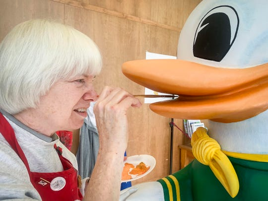 Dolores Weekly, of Salem, works on painting the beak of the Oregon Duck where it, along with other carousel animals, are being painted in preparation for them to be installed on the carousel. Salem's Riverfront Carousel will be fitted with 12 new animals.