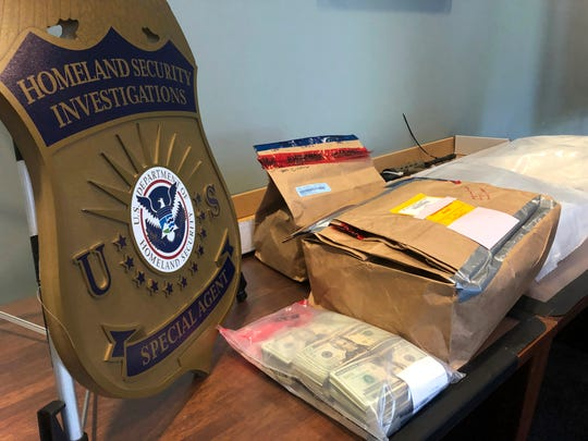 Evidence bags and money are displayed at a news conference, Wednesday, Oct. 2, 2019, in Portland, Ore. U.S.
