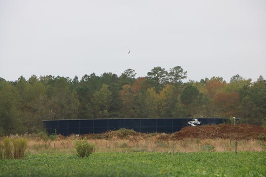 A storage tank for recycled chicken slurry stands on private property on Snethan Church Road, south of Sharptown, Tuesday, Oct. 3, 2019. The open-topped tank is similar to the one slated to be built by Hebron-area farmer Biff Burns and which is causing controversy among neighbors to the tank site.