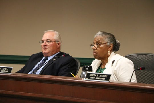 From left: County Commissioners Jim Bunting Jr. and Diana Purnell listen to the White Horse Park text amendment at a commissioner meeting on Sept. 17 in Snow Hill.