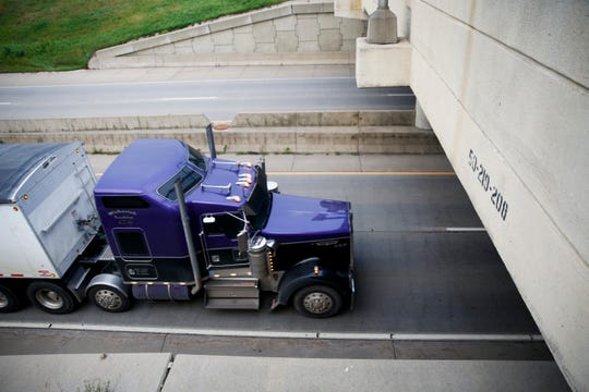 """Truckers participate in a """"slow roll"""" protest on I-229 near 10th Street on Thursday, Oct. 3, 2019. The demonstration is protesting legislation concerning the trucking industry."""