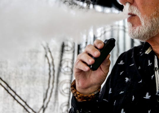 Co-owner James Luther vapes in his store, Blown Away, on Thursday, Oct. 3, 2019. The owners have noticed a decline in sales with recent reports of vaping related illnesses.