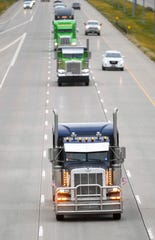 """Truckers participate in a """"slow roll"""" protest on I-29 near 41st Street on Thursday, Oct. 3, 2019. The demonstration is protesting legislation concerning the trucking industry."""