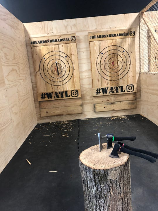 Beards and Broads in Harrisonburg, a new ax-throwing business where people can come and throw axes, recently opened.