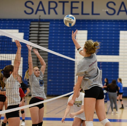 Sartell junior Elizabeth Dille tips the ball during practice Wednesday, Oct. 2, 2019, at Sartell High School.