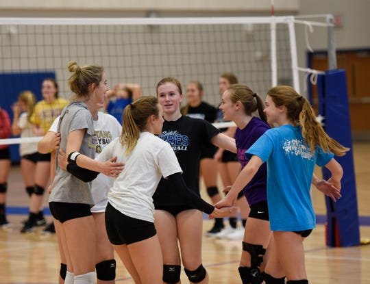 The Sartell volleyball team huddles up after scoring a point at practice Wednesday, Oct. 2, 2019, at Sartell High School.