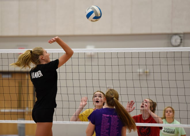 Sartell junior Katelyn Hammer goes up for a spike in practice Wednesday, Oct. 2, 2019, at Sartell High School. The Sabres are the No. 1 seed in Section 8-3A.