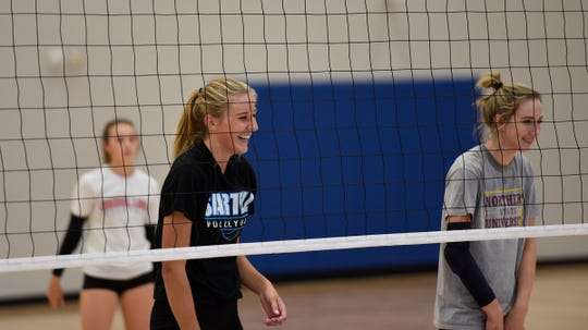 Sartell juniors Katelyn Hammer (left) and Elizabeth Dille smile during practice Wednesday, Oct. 2, 2019, at Sartell High School.