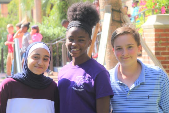 From left, Saja Halloum, Sarah Huff and Curtis Holland stand together Thursday, Oct. 3, 2019 outside the Ruby Diamond Concert Hall. The Cobb Middle students had just seen performance by the Hiplet Ballerinas.