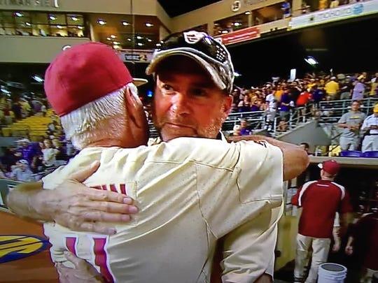 John Lata and FSU baseball coach Mike Martin embrace following the Seminoles' postseason win at LSU
