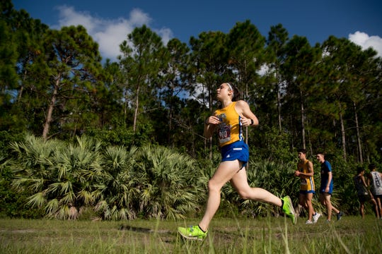 Martin County's Gina Fuca sprints in the last stretch to come in first with a comfortable lead in the girls varsity 5K at the Tommy Lacayo Memorial Invitational high school cross country meet Wednesday, Oct. 2, 2019, at McCarty Ranch Preserve in St. Lucie County.