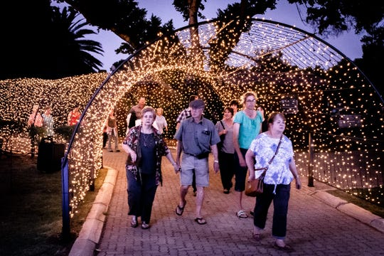 Visitors make their way through the entry to the LiggieFees Festival of Lights at the Abraham Kriel Child &Youth Care Center in South Africa.