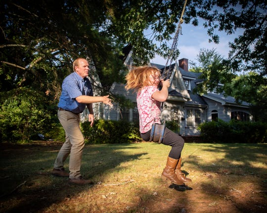 Abby Starkey, 10, gets a push on a swing from her father Charlie Starkey at their home in Clemson.