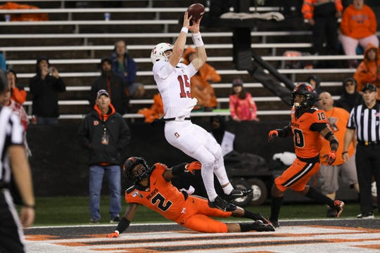 Stanford quarterback Davis Mills catches a touchdown pass from tight end Colby Parkinson, an Oaks Christian School graduate, during the Cardinal's win over Oregon State last Saturday.