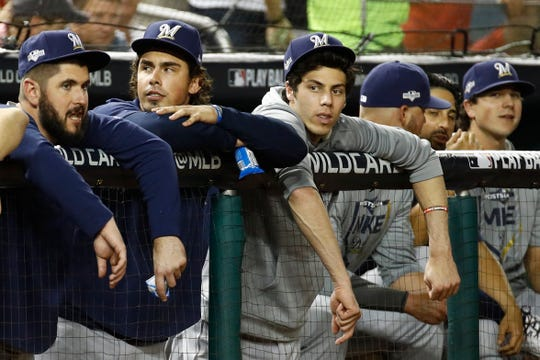 Westlake High graduate Christian Yelich, third from left, had to watch from the dugout during the Brewers' heartbreaking wild-card game loss to the Nationals on Tuesday.