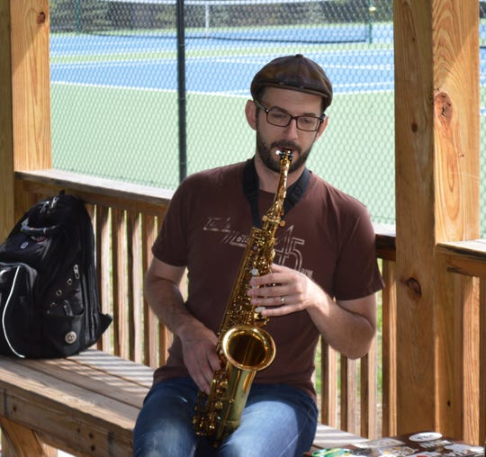 Mike Thibault, on saxophone, at an afternoon jam session at Swing Out New Hampshire.