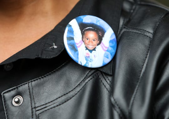 A supporter wears a button of Gabrielle White at the sentencing of Neil White for the murder of his 7-year-old daughter at Westchester County Court in White Plains Oct. 3, 2019. White was sentenced to 25 years to life in prison.