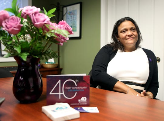 Elizabeth Santiago, CEO of Center for Safety and Change talks about the centers upcoming 40th anniversary in her office in New City Oct. 3, 2019.
