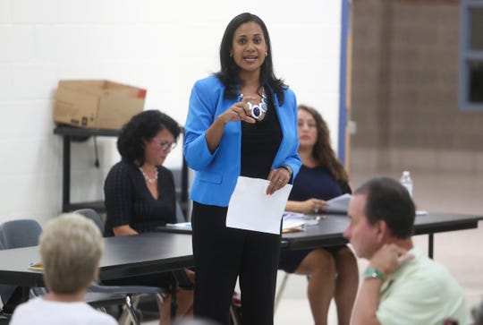 Delaware Secretary of Health Kara Odom Walker speaks to residents about The Refuge treatment facility in Bear at a public meeting Wednesday.